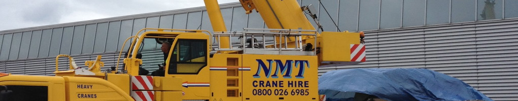 An NMT crane preparing to lift a tank