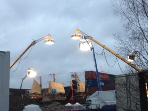 Cranes holding lights