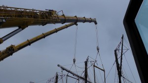 A picture of a crane lifting a ship for a film