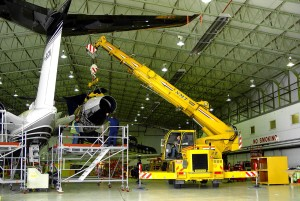 A picture of an NMT Crane lifting an aeroplane