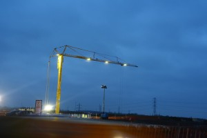 A picture of an NMT Crane lit up on a construction site