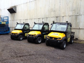 A picture of 3 small JCB buggies