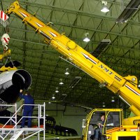 Crane lifting a jet engine