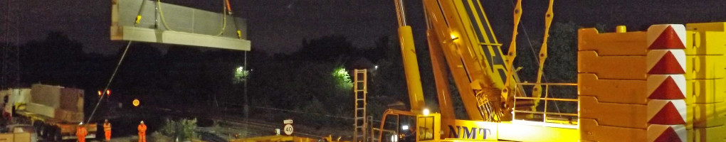 A picture of an NMT Crane Hire crane using a block grab