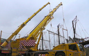 A crane from NMT Crane Hire in action