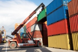 A picture of an NMT Crane Hire crane moving a container unit
