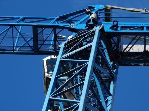 A close up photo of a blue crane hire taken with a bright blue sky as the background