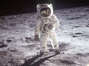 A picture of an astronaut walking across the surface