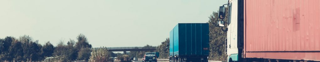 A picture of two heavy haulage vehicles driving down the motorway
