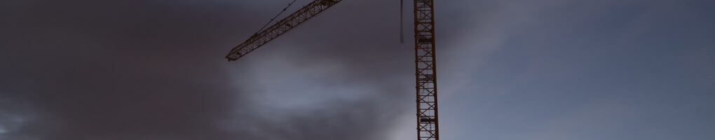 A picture of a crane operating in bad weather