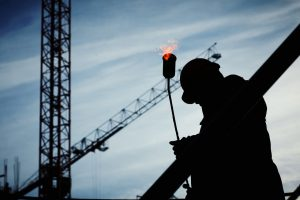A crane operator carrying out routine crane safety checks