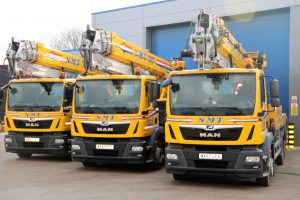 A picture of three NMT cranes for hire