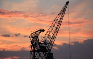 image of a harbour crane at sunset