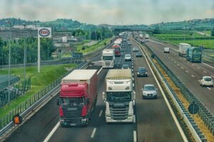 Image of two trucks driving down a motorway